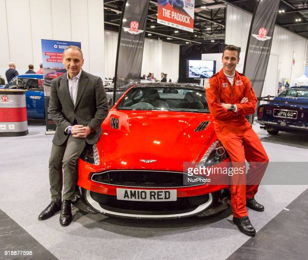 RAF Red Arrows Squadron Leader Adam Collins and a man who won the car in a lottery with Aston Martin 10 at the ExCel Exhibition Centre in London...