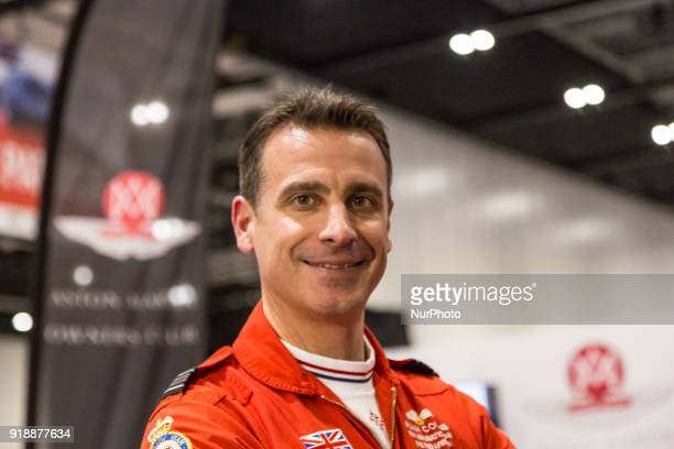 RAF Red Arrows Squadron Leader Adam Collins with Aston Martin 10 at the ExCel Exhibition Centre in London during The London Classic Car Show on...
