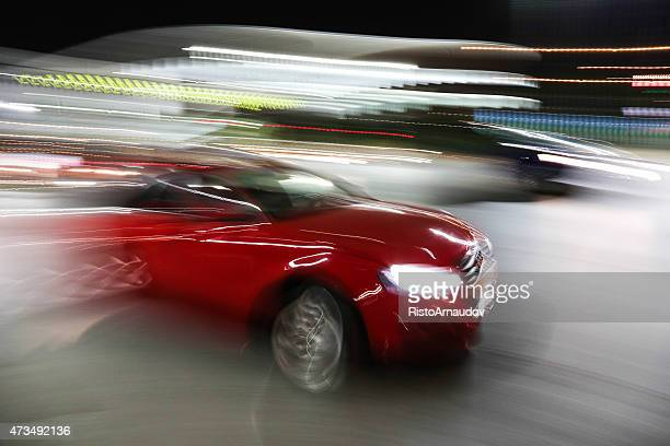 red audi in motion drive fast - audi stock pictures, royalty-free photos & images