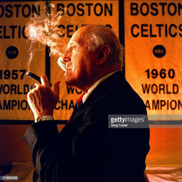 Red Auerbach former head coach and General Manager of the Boston Celtics poses for a portrait in front of Celtics championship banners in Boston...