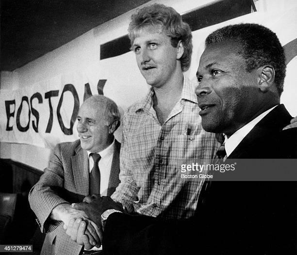 Red Auerbach Larry Bird and K C Jones at TD Bank Garden Signing