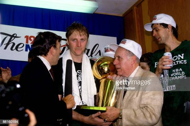 Red Auerbach Larry Bird and Kevin McHale of the Boston Celtics celebrate following Game Six of the 1986 NBA Finals at the Boston Garden played on...