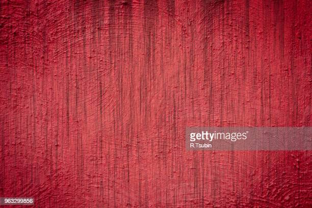Red background wall texture with dark edges