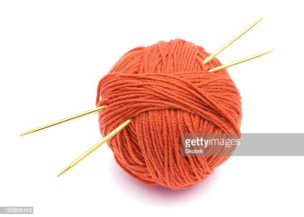 Red ball of wool and knitting needles