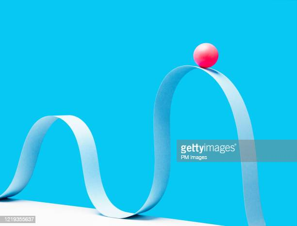 red ball on crest of the wave - flexibility stock pictures, royalty-free photos & images