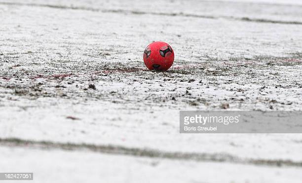 A red ball sits on a snow covered pitch during the Third League match between Hallescher FC and Chemnitzer FC at Erdgas Sportpark on February 23 2013...