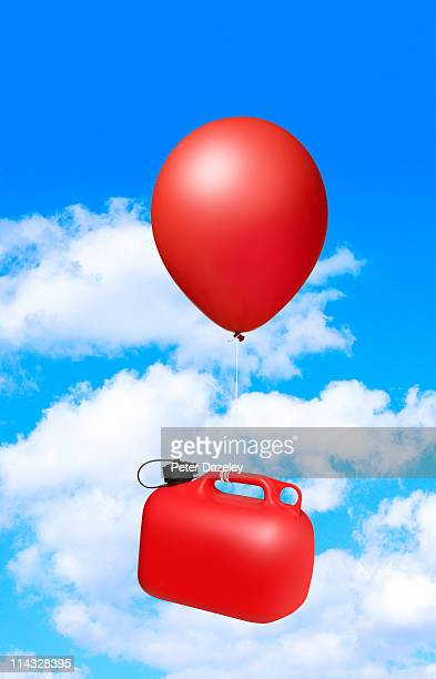 Red ballon lifting leaded petrol can