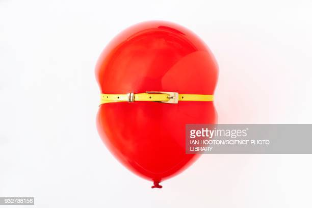 red balloon, conceptual image of bloated stomach - red belt stock photos and pictures