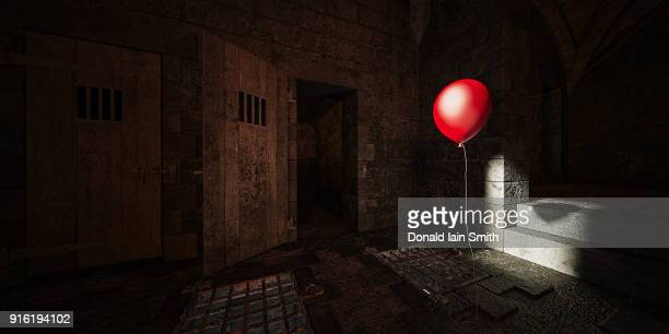 Red balloon floating in dark dungeon