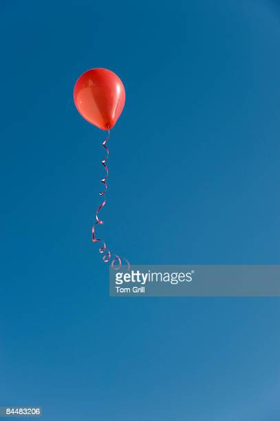 Red balloon floating in the sky