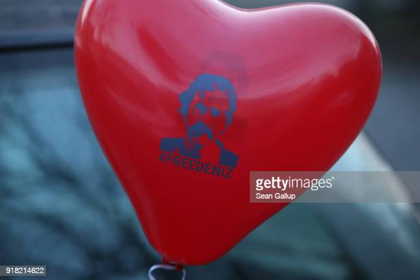 A red balloon in the shape of a heart that reads 'Free Deniz' in reference to Deniz Yucel a GermanTurkish journalist imprisoned in Turkey decorates a...