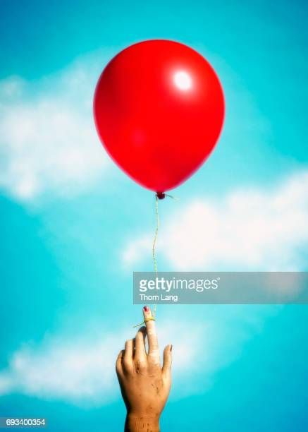 Red Balloon Tied to Finger