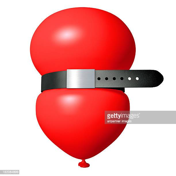 red balloon with a pants belt on white - red belt stock photos and pictures