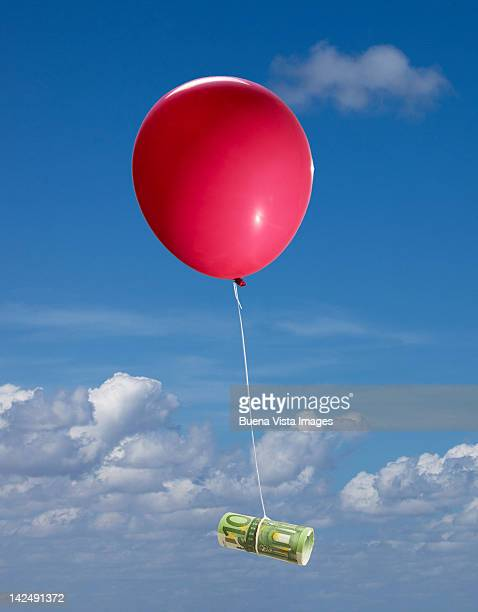 red balloon with euro bills