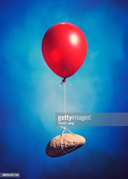 Red Balloon With Floating Rock