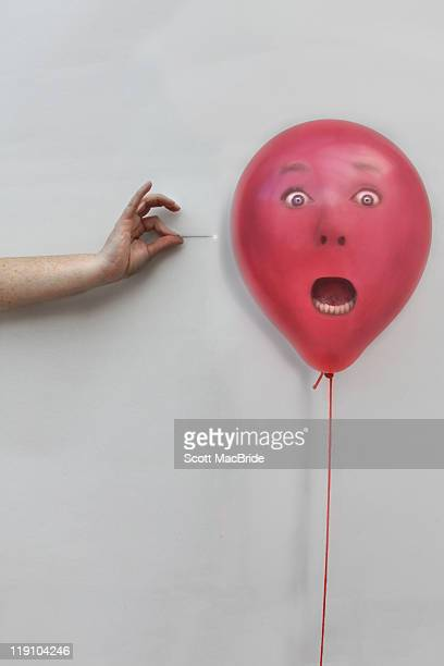 Red balloon with scared face