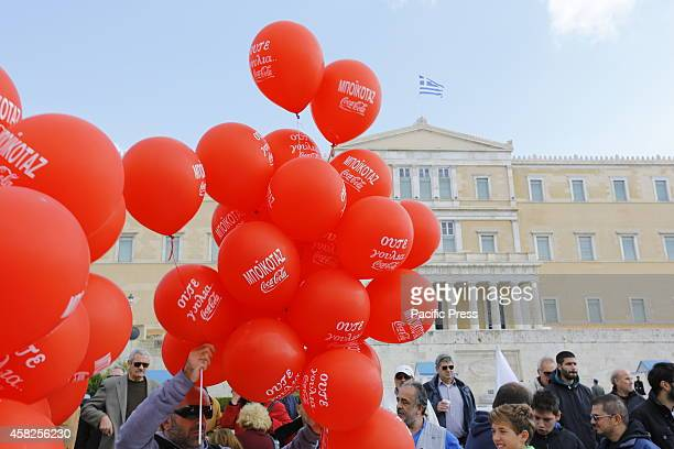 SQUARE ATHENS ATTICA GREECE Red balloons calling for a boycott of Coca Cola fly in sight of the Greek Parliament Thousands of protesters assembled in...