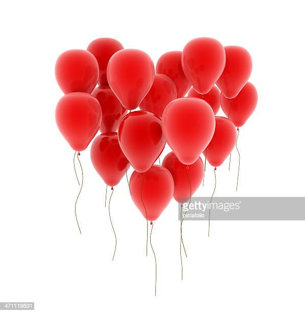 Red balloons forming the shape of heart on white background