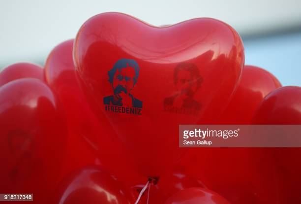 Red balloons in the shape of a heart that read 'Free Deniz' in reference to Deniz Yucel a GermanTurkish journalist imprisoned in Turkey decorate a...