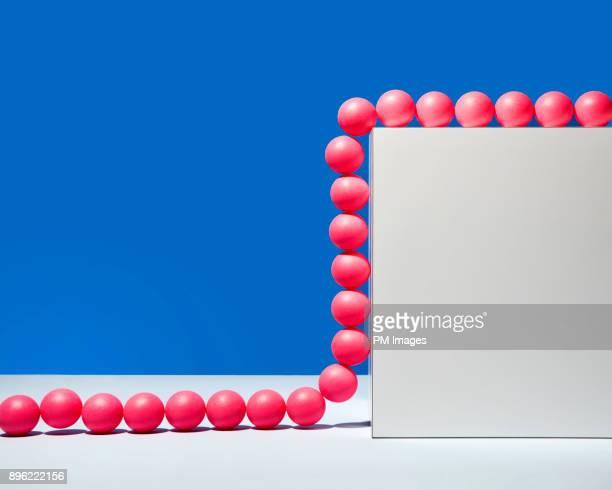 Red balls climbing a wall