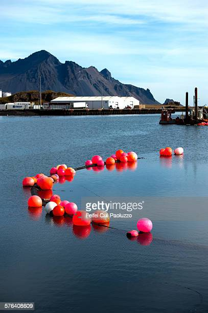 red balls in harbor of hofn at austurland iceland - austurland stock pictures, royalty-free photos & images