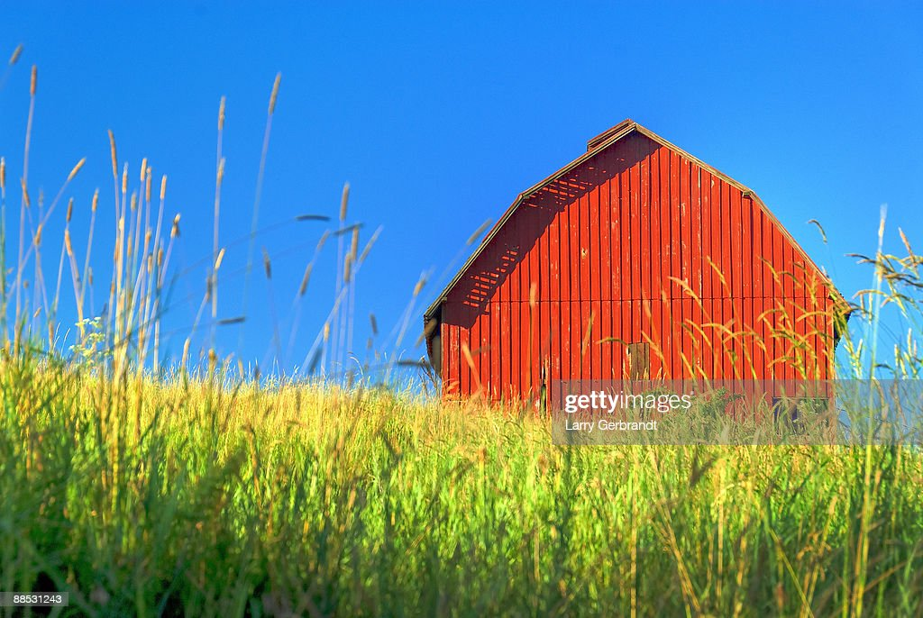 Red Barn Against Blue Sky : Stock Photo