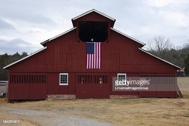 Red Barn and US Flag outside of Franklin Tennessee a suburb south of Nashville Williamson County Tenn