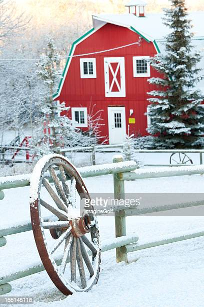 Red Barn and Wagon Wheel in Winter