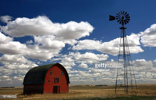 red barn and windmill - old windmill stock photos and pictures