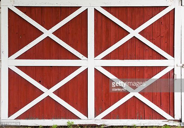 Red barn doors with white trim