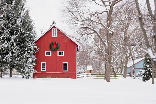 Red barn in the snow - rural winter scene 1141535919
