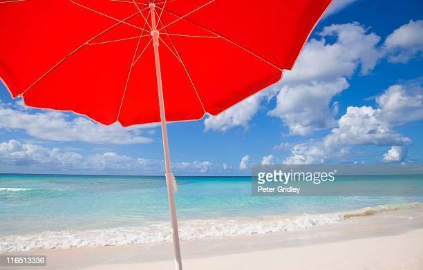 Red beach umprella, sky, sea, surf, sand