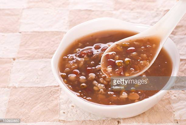 red bean mixed congee - congee stock photos and pictures