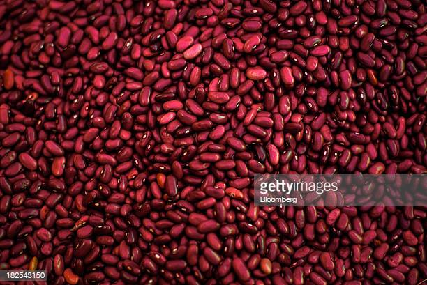 Red beans are displayed for sale at an open-air market in Tegucigalpa, Honduras, on Saturday, Sept. 7, 2013. Economic growth in Honduras is forecast...