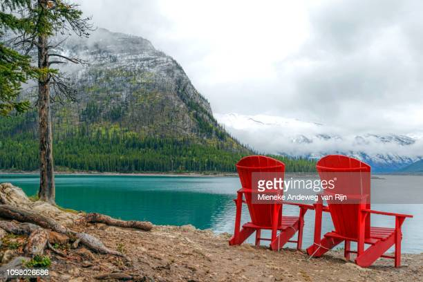 Red bear chairs at Lake Minnewanka, in Banff National Park, Rocky Mountains, Alberta, Canada, North America
