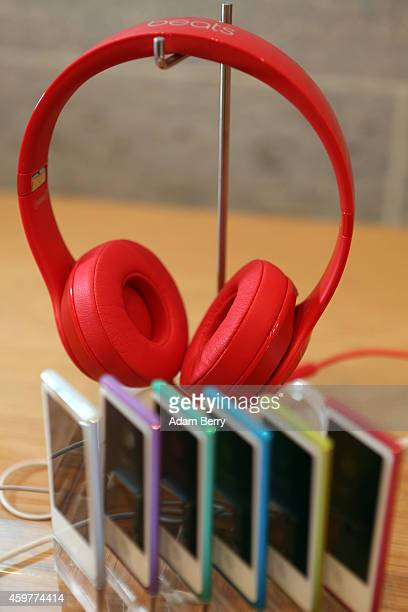 Red Beats by Dre headphones are seen on display behind iPod Nanos at the Apple Store on December 1 2014 in Berlin Germany On World AIDS Day December...