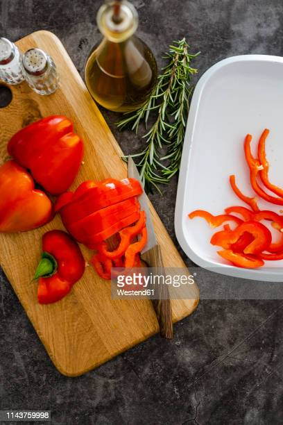 red bell pepper on chopping board, chopping - red bell pepper stock pictures, royalty-free photos & images
