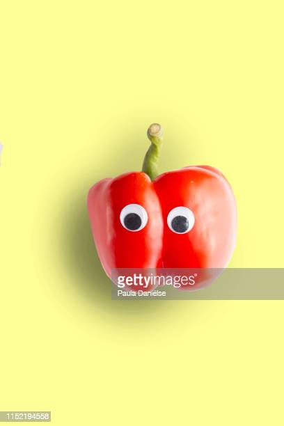 red bell pepper with googly eyes - googly eyes stock pictures, royalty-free photos & images