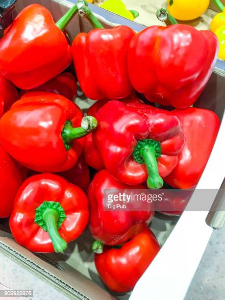 Red bell peppers in cardboard box