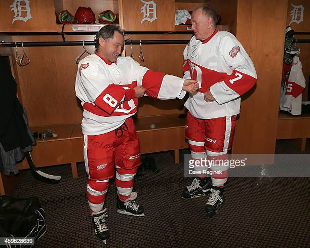 Red Berenson and Dennis Polonich of the Detroit Red Wings Alumni chat as they get dressed to play against the Toronto Maple Leafs Alumni during the...