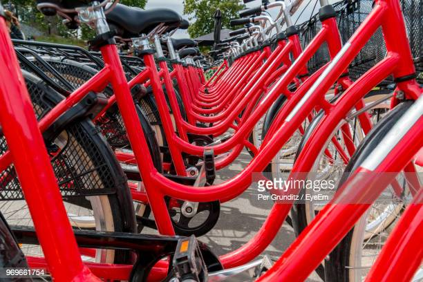Red Bicycles Parked On Footpath