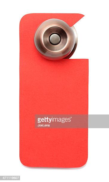 A red blank door sign hanging on the knob