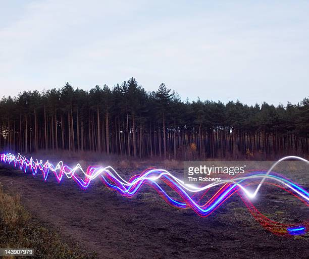 red, blue and white light trails on heath. - fibre stock pictures, royalty-free photos & images