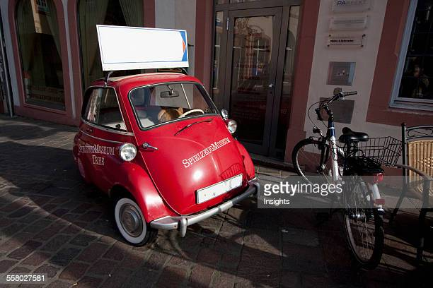 Red BmwIsetta Car In Front Of The Spielzeug Museum Trier RhinelandPalatinate Germany