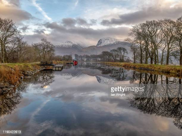 red boat, caledonian canal, corpach #2 - moment of silence stock pictures, royalty-free photos & images
