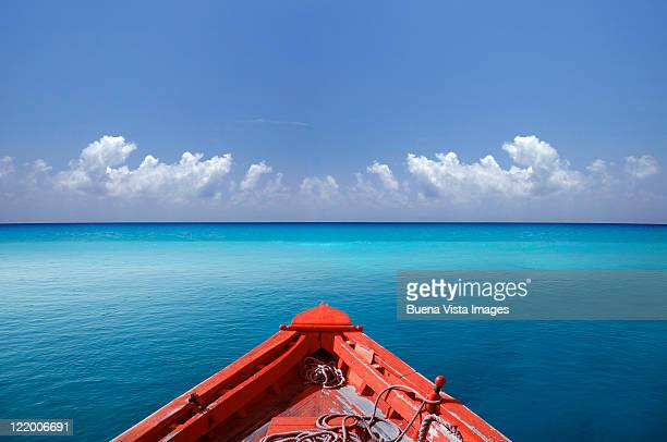 Red boat in a blue sea