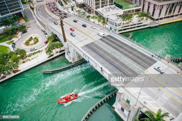 Red Boat on Miami River Drives Under Brickell Avenue Bridge