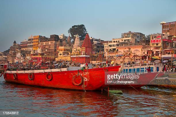 Red boats moored at Ganges river in Varanasi,India