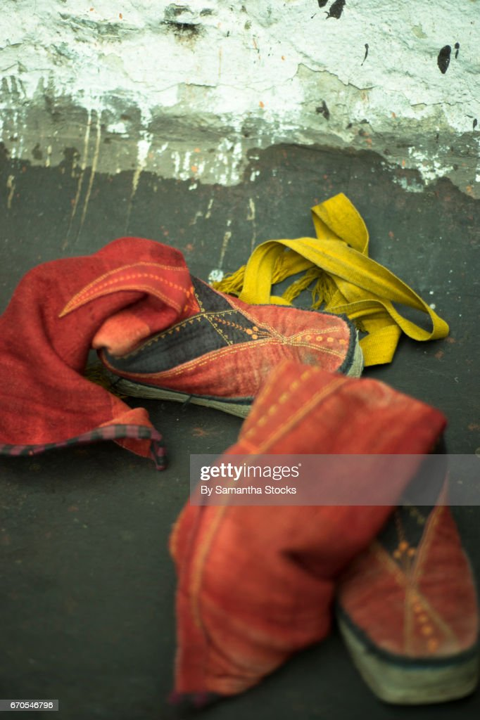 Red boots at a Tibetan monestary : Stock Photo
