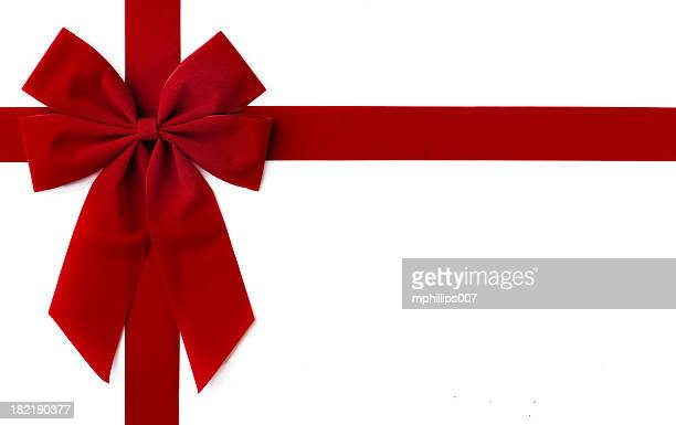 red bow gift - velvet stock photos and pictures